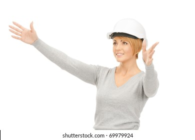 picture of female contractor in helmet working with something imaginary