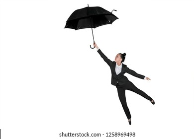 Picture of female entrepreneur flying with an umbrella in the studio, isolated on white background
