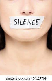 "A picture of a female face with a tape on her mouth and a notice ""silence"""