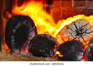 Picture of a fire. Burning coal in fireplace.