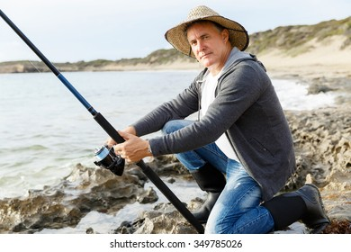 Picture of fisherman fishing with rods