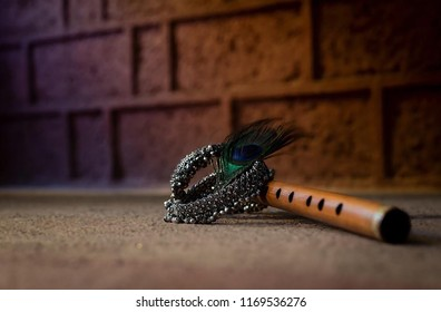 Picture of a flute and crown. Krishna Janmashtami is an annual Hindu festival that celebrates the birth of Krishna, the eighth avatar of Vishnu.