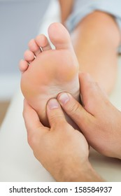 Picture of foot massage given from physiotherapist in bright office