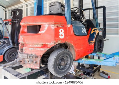 Picture of forklift in car repairing workshop