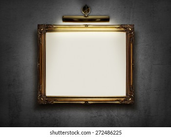 Picture frame with blank canvas hanging on a wall in an art museum