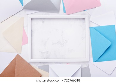 Picture frame with mail envelopes border mockup or template top view. Styled background for correspondence design. Flat lay.