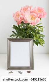 picture frame mock up with peonies