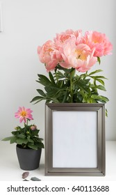 picture frame mock up with peonies and dahlia