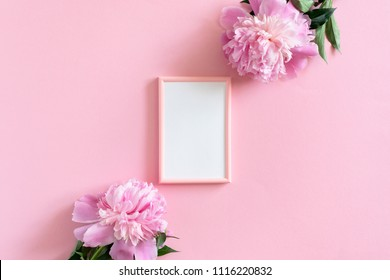 Picture frame mockup and peonies on a pink pastel background