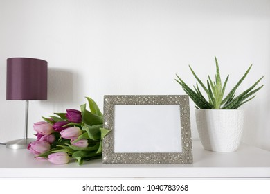 Picture Frame Mockup with tulips and table lamp