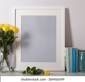 Picture frame on desk with flowers