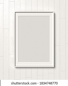 Picture frame on a white wooden wall white frame. Blank Mockup