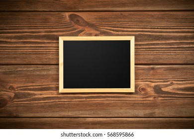 Picture frame on a wooden wall