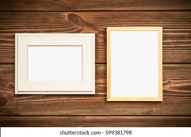 Picture frame on a wooden wall.