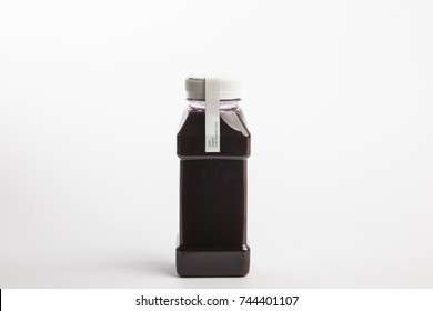 Picture of fresh pressed organic beet juice in plastic bottle on the white background. Healthy drink. Detox diet