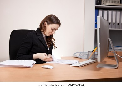 Picture of frustrated businesswoman with financial report at office
