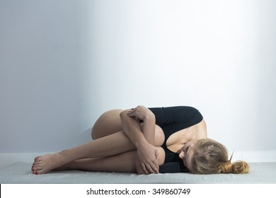 Picture of girl lying suffering from menstrual cramps