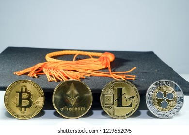 A picture of graduation mortarboard with Bitcoin, Ethereum, Lite and Ripple Coin. It is the symbol of crypto currency will be use in education.