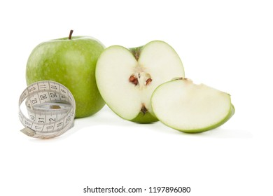 Picture of green apples and tape measure isolated on white. Healthy food.