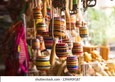 a picture of a group of a multicolor mexican  balero, a typical mexican toy and a handcraft, taken in a marketplace,