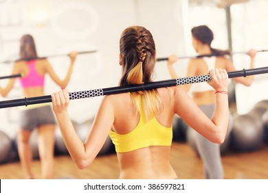 A picture of group women working out in gym