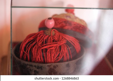 It's a picture of handmade headwear that is used by the Baba & Nyonya race, during a long time ago. The headwear is placed inside a glass mirror to keep it's originality as a show case to the youth