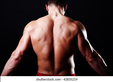Picture of handsome athlete from behind