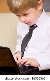 picture of happy boy with black laptop computer