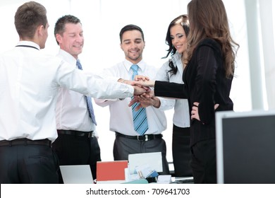 Picture of happy business people celebrating victory in office