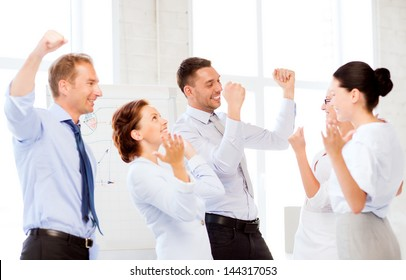 picture of happy business team celebrating victory in office