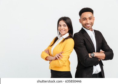 Picture of happy colleagues business team standing over white background isolated. Looking at camera.