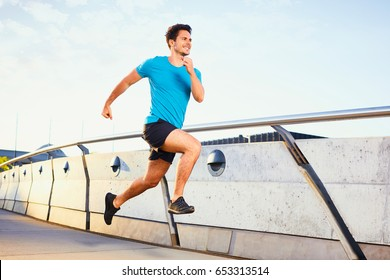 Picture of happy man running on bridge