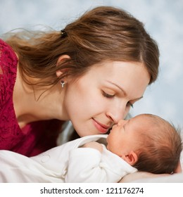 picture of happy mother with baby in bedroom