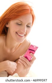 picture of happy redhead woman with cell phone
