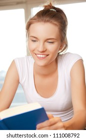 picture of happy and smiling teenage girl with book..