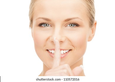 picture of happy woman with finger on lips