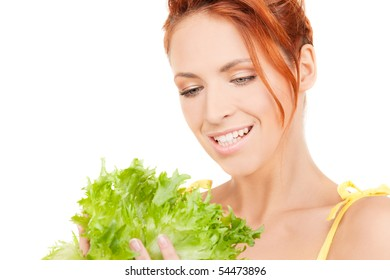 picture of happy woman with lettuce over white