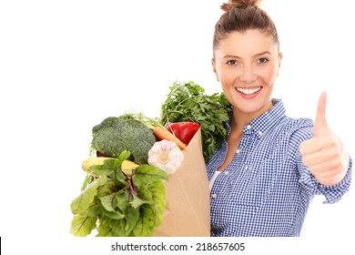 A picture of a happy woman with vegetables showing ok over white background