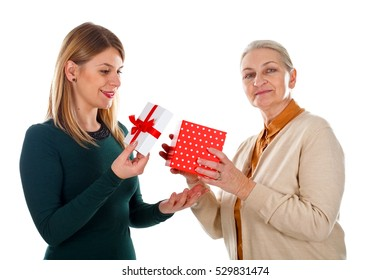 Picture of a happy young woman giving her mother a Christmas gift