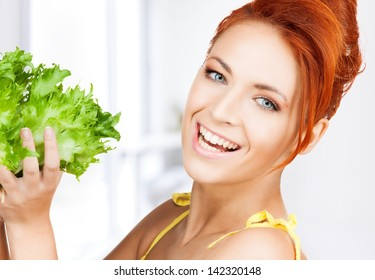 picture of healthy woman holding bunch of lettuce