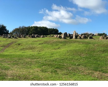Picture of Lindhølm hoje in Denmark, mass viking grave, near the city of aalborg. Picture taken in summer with blue sky and few clouds.