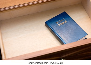 Picture of Holy Bible in a hotel room nightstand open drawer with copy space for adding text