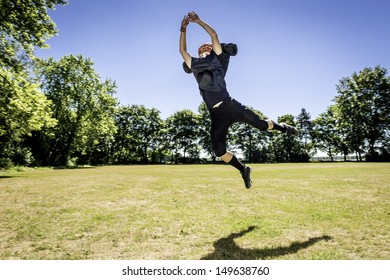 Picture of a jumping American Football Player