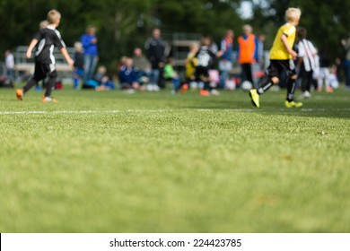 Picture of kids soccer training match with shallow depth of field.