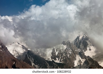 Picture a landscape of snow tops of mountains in the background of the beautiful white clouds. Switzerland.