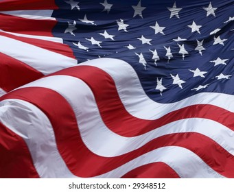 Picture of a large American flag waving in the wind