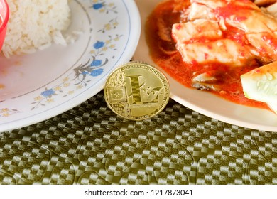 A picture of Lite Coin and chicken rice. Lite Coin will be use in food industry transaction.