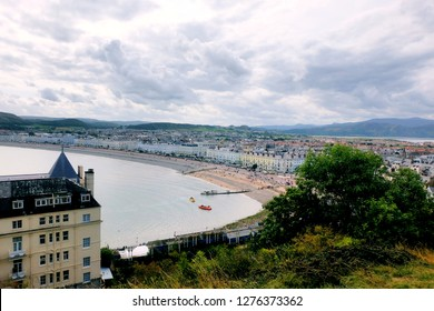 A picture of Llandudno Town from a hill during daylight.