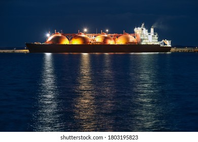Picture of LNG tanker in port at night.