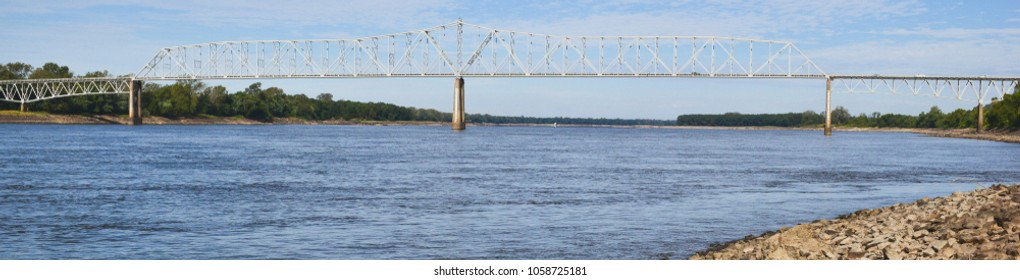 A picture of a long bridge reaching across Mississippi river